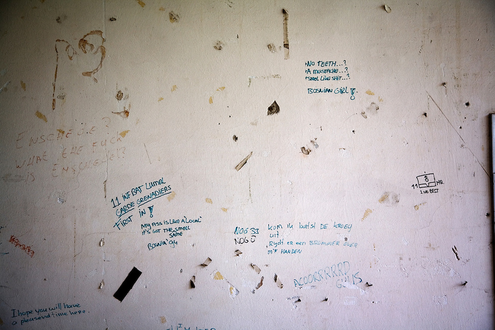 The view from the Dutch officer's quarters at the Potocari battery factory outside of Srebrenica. Infamous graffiti reading 'No Teeth? A Mustache? Smell like shit? Bosnian Girl!'.
