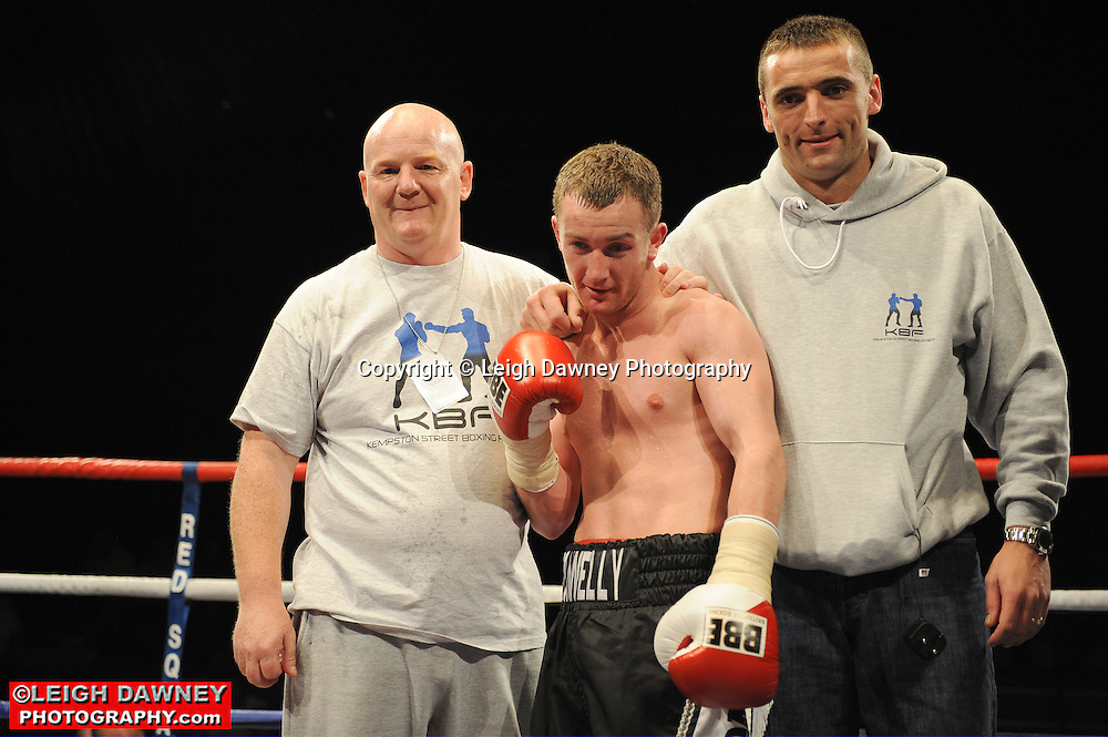 John Donelly (black shorts) defeats Andy Bell at Huddersfield Leisure Centre on 28th May 2010. Frank Maloney Promotions. Photo credit: © Leigh Dawney