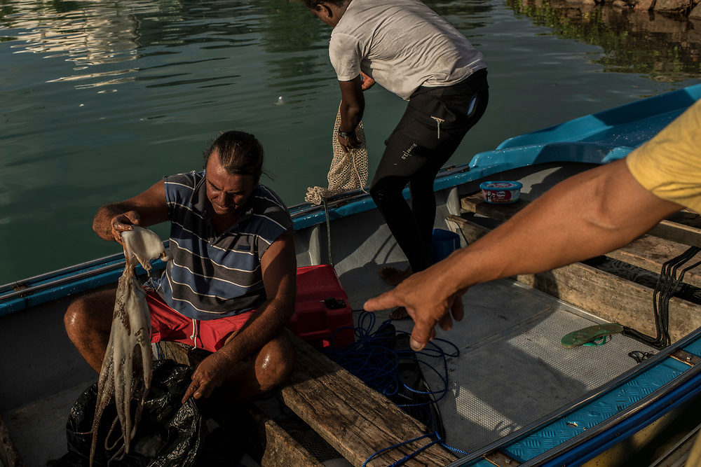 Fishermen return home for the day at a marina in Bel Ombre, Seychelles on February 19, 2018. Fishing and tourism in the Seychelles generate 43 percent of the country's income.<br /> <br /> The government of Seychelles has created 81,000 square miles of Marine Protected Areas as part of a conservation debt swap deal in an effort to shield marine ecosystems from unsustainable development and climate change while safeguarding its economy.