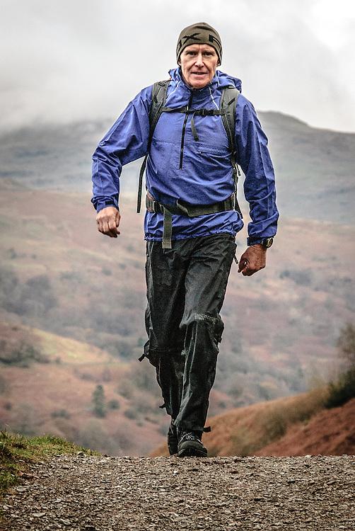 Renowned British high altitude mountaineer, Alan Hinkes, walking in the Lake District,UK