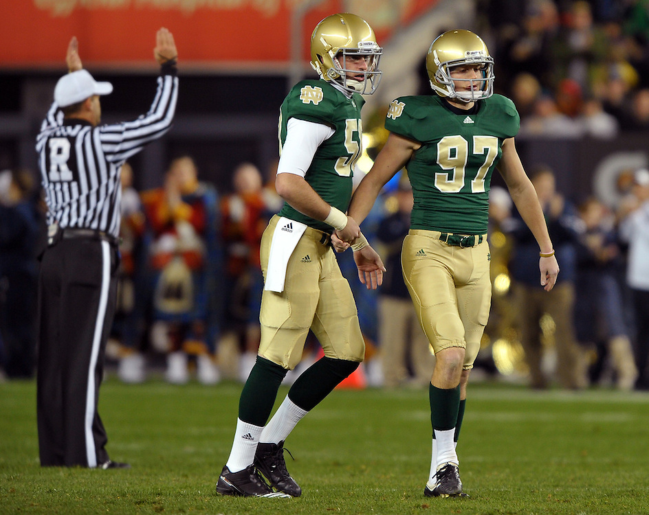 Irish kicker David Ruffer (97) is congratulated by holder Ryan Kavanagh (50) after the first of his two field goals.