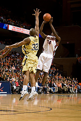 Virginia guard Sean Singletary (44) shoots over Georgia Tech forward Jeremis Smith (32).  The Virginia Cavaliers men's basketball team fell to the Georgia Tech Yellow Jackets 92-82 in overtime at the John Paul Jones Arena in Charlottesville, VA on January 27, 2008.