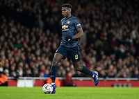 Football - 2018 / 2019 FA Cup - Fourth Round: Arsenal vs. Manchester United <br /> <br /> Paul Pogba (Manchester United) breaks through the Arsenal defence and heads to goal at The Emirates Stadium.<br /> <br /> COLORSPORT/DANIEL BEARHAM
