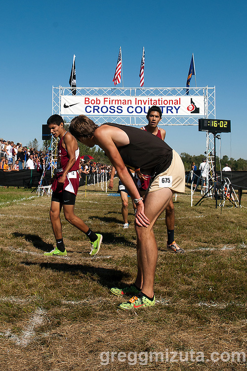 Davis senior Brad Nye looks back to the finish line towards Arcadia's Sergio Gonzalez and Ryan Vargas during the Bob Firman elite race on September 24, 2011. Nye finished second and was followed by Gonzalez and Vargas on the 5k course at Eagle Island State Park in Eagle, Idaho.