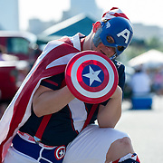 May 26 2012: A USA fan dressed as Captain America poses for a photo while tailgating before the U.S. Men's National Soccer Team game against Scotland at Everbank Field in Jacksonville, FL.