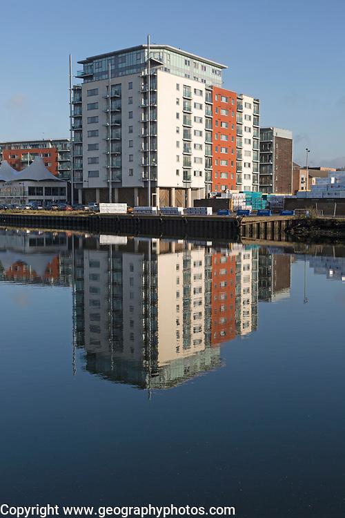 Modern apartments architecture reflected in water Ipswich Wet Dock waterside redevelopment, Ipswich, Suffolk, England, Uk
