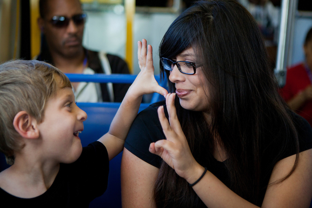 SAN DIEGO, CA - JULY 8, 2014:  Jannette Navarro and her son Gavin ride their first bus of the day after two trolley rides on the way to school and work, respectively. Navarro drops her son off at a daycare center before heading to her job at Starbucks Coffee in the Kearny Mesa neighborhood of San Diego. CREDIT: Sam Hodgson for The New York Times
