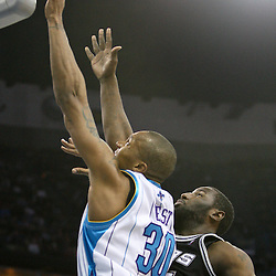 Mar 01, 2010; New Orleans, LA, USA; New Orleans Hornets forward David West (30) shoots over San Antonio Spurs forward DeJuan Blair (45) during the second half at the New Orleans Arena. The Spurs defeated the Hornets 106-92. Mandatory Credit: Derick E. Hingle-US PRESSWIRE
