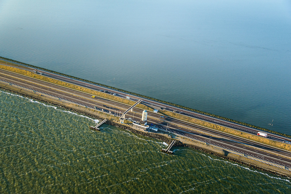 Nederland, Noord-Holland, Den Oever, 11-12-2013; Afsluitdijk met Monument. Waddenzee boven in beeld.<br /> Enclosure Dam with Monument. Waddenzee (left), Friesland on the distant horizon.<br /> luchtfoto (toeslag op standaard tarieven);<br /> aerial photo (additional fee required);<br /> copyright foto/photo Siebe Swart.