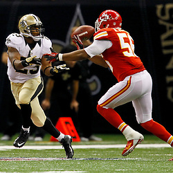 September 23, 2012; New Orleans, LA, USA; New Orleans Saints running back Pierre Thomas (23) catches a pass over Kansas City Chiefs linebacker Derrick Johnson (56) during the second quarter of a game at the Mercedes-Benz Superdome. Mandatory Credit: Derick E. Hingle-US PRESSWIRE