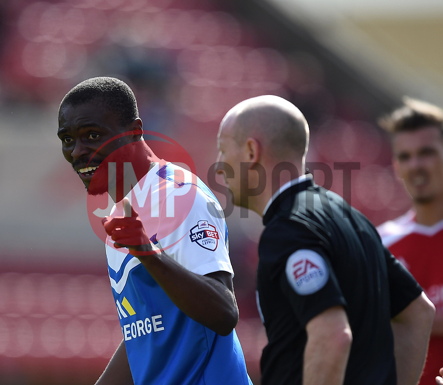 Peterborough United's Gabriel Zakuani remonstrates with referee Andy Davies - Photo mandatory by-line: Paul Knight/JMP - Mobile: 07966 386802 - 11/04/2015 - SPORT - Football - Swindon - The County Ground - Swindon Town v Peterborough United - Sky Bet League One
