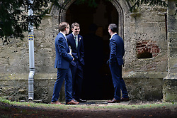 Former Prime Minister Tony Blair's Son Euan Blair Wedding to Suzanne Ashman at All Saints Church in  Wotton Underwood, United Kingdom. Saturday, 14th September 2013. Picture by Ben Stevens / i-Images<br /> <br /> Picture is Euan Blair greeting guests at All Saints Church (second left).