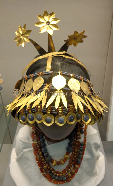Headdress of Princess Puabi. Sumerian, 2600 BC. Silver head ornament with gold, lapis lazuli, shell and red limestone inlay. Held at the British Museum, London.