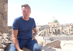"""EXCLUSIVE: POSTCARD FROM MOSUL, A BRITISH DAD HAS BECOME THE FIRST PERSON TO TAKE A HOLIDAY IN THE RUINS OF ISLAMIC STATE – AND HE'S EVEN INTERVIEWED AN ISIS BRIDE A married British dad has become the first person to take a HOLIDAY in the ruins of the ISLAMIC STATE. Without visas and in constant danger of kidnapping, beatings from militia, and even death, Andy Drury took a £4,000 three-day mini break in what was once Hell on Earth. Dad-of-four Andy, 53, has brought back never-before-seen photographs of the devastated former ISIS Caliphate centre Mosul, in Northern Iraq. And amidst shocking apocalyptic scenes the innocent survivors and their families have spoken to him about trying to rebuild their lives in the rubble. The building firm owner, from Guildford, Surrey, even gained access to an ISIS bride whose husband and two sons are all believed to have fought for the death cult. Andy has spent the last 20 years touring areas of the planet most us don't dare tread and it's not the first time he's been to Iraq. In 2016 he narrowly escaped death after visiting the frontline in Bashiir, south of Kirkuk, where he spent time with Kurdish soldiers fighting ISIS. During that encounter Andy, who doesn't wear a bulletproof vest or helmet, was shot at by Islamic State but luckily escaped unharmed. Andy, who lives with his wife and children, said his biggest reason for returning to the dangerous region last month was to see if the men he spent time with on the front line were still alive. His three-day tour was split into the former front line near Kirkuk on day one, the former ISIS stronghold Mosul on day two, and a last day visiting a refugee camp and interviewing an ISIS wife. Andy said: """"I must be the first person to be have been a tourist in the ruins of Islamic State. """"My fixer Ammar (not his real name) was right on the front line for the taking back of Mosul, taking reporters in there. """"But he said he is more scared with me, with the news reporters he"""
