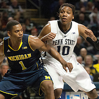 Michigan's Glenn Robinson III (1) tries to box out Penn State's Brandon Taylor (10) during the first half of an NCAA college basketball game in University Park, Pa., Wednesday, Feb. 27, 2013.