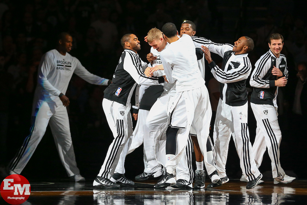 Apr 1, 2014; Brooklyn, NY, USA; The Brooklyn Nets jump on Brooklyn Nets forward Mason Plumlee (1) before the start of their game against the Houston Rockets at Barclays Center.