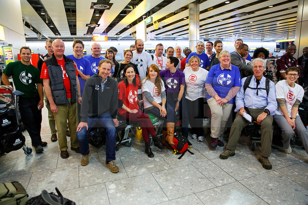 © Licensed to London News Pictures. 22/11/2014. LONDON, UK. 33 NHS Doctors, nurses and paramedics leaving Heathrow Terminal 4 for Freetown, Sierra Leone, where they will start working at British-built Ebola treatment centres across the country with the help of GOAL, a Dublin-based international aid agency on UK Government's order. Photo credit : Tolga Akmen/LNP