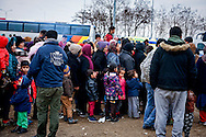 Refugees in line for to eat, while on their way with a bus from Athens to Idomeni village at the Greek - Macedonian border, 8 Febraury 2016. Hundreds of refugees  wait every day at a gas station used as a temporary camp outside of Polykastro city at the north part of Greece until they receive the order from the police to move to the Greece- Macedonian border and continue their trip  to North Europe.