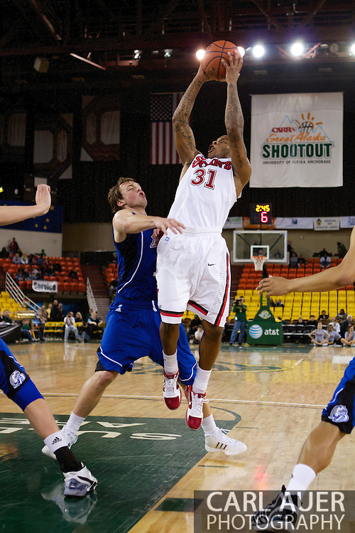 November 26th, 2010:  Anchorage, Alaska - St. John's sophomore guard Malik Stith (31) pulls up for a shot in the Red Storm's semi final game of the Great Alaska Shootout against the Drake Bulldogs.  The Red Storm defense held Drake to a tournament low score as St. Johns advanced to the final game 82-39.