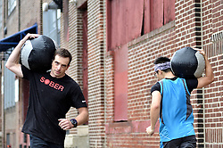 Scott Klaverkamp, a long time participant at Phoenix Multisports, is seen working out at Fearless Athletics, in South Philadelphia, on October 8, 2016. (Bastiaan Slabbers / for phillyvoice)