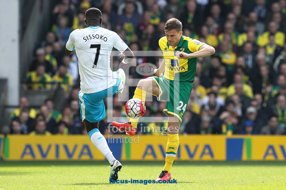 Ryan Bennett of Norwich and Moussa Sissoko  of Newcastle United in action during the Barclays Premier League match at Carrow Road, Norwich<br /> Picture by Paul Chesterton/Focus Images Ltd +44 7904 640267<br /> 02/04/2016