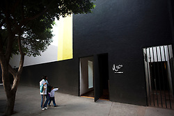 El Eco Museum sits as a huge block shadow in front of a park in Mexico City.