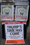 London Evening Standard newspapers feature the headline about Donald Trump's inauguration, on the day of he was made 45th US president, on 20th January, outside Charing Cross station, London borough of Westminster, England. The copies show his face and that of his wife, Melania Trump.
