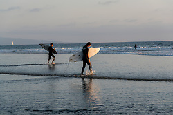 Rachelle Rodriguez stands in the artist quarters of San Juan, Puerto Rico, October 1, 2014. (Photo By Ami Vitale)Surfers head out for a sunset wave in Venice Beach, California October 9, 2014. (Photo by Ami Vitale)