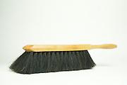 still life of a dustpan brush