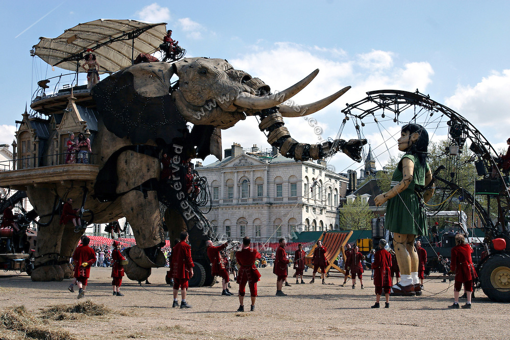 The gigantic mechanical elephant, and the Sultan, encounter the  Little Girl of the play. The Sultan's Elephant show, for the first time in London, on Friday, May 5, 2006, is a magical, and unique in the world, theatrical show across the streets, performed by an international French company - Royal De Luxe - specialised in constructing and giving 'life' to enormous mechanical puppets. The Sultan's Elephant is the story of a Sultan dreaming of a little girl that travels through time. **ITALY OUT**