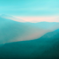 Ridges of Smoky Mountains appearing to glow with evening mist.  Abstract effect created with lens movement during long exposure.