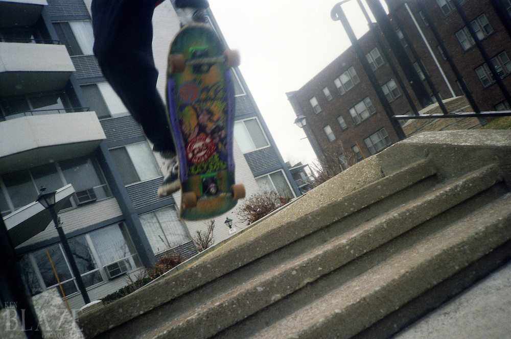 An old school skateboarder ollies down stairs in 1989.