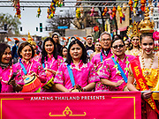 "29 APRIL 2017 - MINNEAPOLIS, MINNESOTA: Thai-Americans wearing traditional Thai holiday shirts perform Thai music during the parade at Songkran Uptown. Several thousand people attended Songkran Uptown on Hennepin Ave in Minneapolis for the city's first celebration of Songkran, the traditional Thai New Year. Events included a Thai parade, a performance of the Ramakien (the Thai version of the Indian Ramayana), a ""Ladyboy"" (drag queen) show, and Thai street food.     PHOTO BY JACK KURTZ"