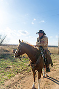 Brian Mayfield of Sayre sits astride his horse at the Packsaddle Wildlife Management area south of Arnett, Oklahoma.