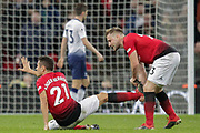 Manchester United midfielder Ander Herrera (21) runs down the clock in added time with Manchester United defender Luke Shaw (23), during the Premier League match between Tottenham Hotspur and Manchester United at Wembley Stadium, London, England on 13 January 2019.