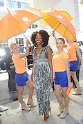 IMAGE DISTRIBUTED FOR ACCUWEATHER -  Actress Teyonah Parris is shaded from the hot summer sun by the AccuWeather MinuteCast street team at New York Fashion Week, on Tuesday, Sept. 15, 2015. The AccuWeather MinuteCast Street Team is at it again helping Fashion Week attendees stay stylish and one-step ahead of any possible precipitation. (Photo by Diane Bondareff/Invision for AccuWeather/AP Images)
