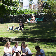 People enjoy lunch in the grounds of Christ Church Cathedral, the Anglican cathedral in Nelson. The cathedral is located at upper Trafalgar Street. Nelson,  New Zealand, 31st January 2011. Photo Tim Clayton.
