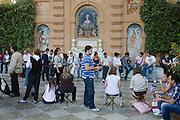 Devout Spaniards await an Easter procession in Jardines de Murillo during Semana Santa.