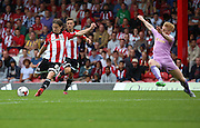 Lasse Vibe (Brentford striker) scoring Brentfords first goal to bring them one in it during the Sky Bet Championship match between Brentford and Reading at Griffin Park, London, England on 29 August 2015. Photo by Matthew Redman.