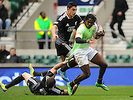 LONDON, ENGLAND - Sunday 11 May 2014, Seabelo Senatla of South Africa is caught by Gillies Kaka of New Zealand during the Cup quarter final match between South Africa and New Zealand at the Marriott London Sevens rugby tournament being held at Twickenham Rugby Stadium in London as part of the HSBC Sevens World Series.<br /> Photo by Roger Sedres/ImageSA