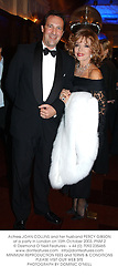 Actress JOAN COLLINS and her husband PERCY GIBSON at a party in London on 15th October 2003.PNM 2