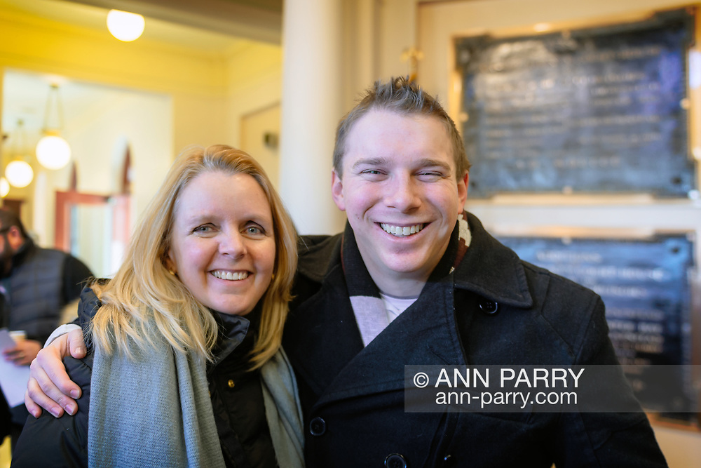 Mineola, New York, USA. January 1, 2018. L-R, Nassau County Legislators DEBRA MULE, 55, (Freeport - 5th District - Democrat) and JOSHUA LAFAZAN, 23, (Syosset - 18th District - Independent) are in Theodore Roosevelt Executive & Legislative Building after attending the outdoor historic swearing-In of Laura Curran as Nassau County Executive. Lafazan is a registered Independent and Nassau County's youngest ever legislator. Mule has Curran's former Legislative seat.