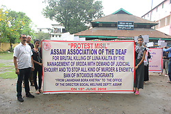 """June 15, 2018 - Guwahati, Assam, India - Member of """"Assam Association of Deaf"""" taking out a rally demanding judicial inquiry of brutal killing of Luna Kalita and to stop all kind of murder and enmity. (Credit Image: © David Talukdar/Pacific Press via ZUMA Wire)"""
