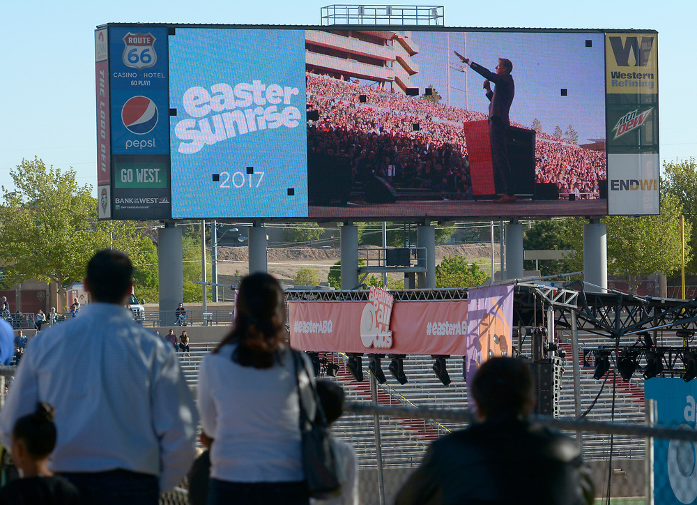 gbs041617c/ASEC -- The University Stadium scoreboard shows the video of  Calvary Albuquerque Pastor Skip Heitzig as he preaches during the  Easter Sunrise Service Against All Odds Albuquerque Journal)