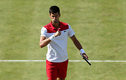 Serbia's Novak Djokovic reacts during day four of the Fever-Tree Championship at the Queen's Club, London.