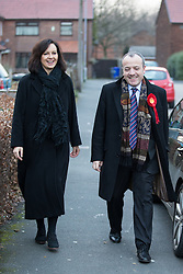 © Licensed to London News Pictures . 30/01/2014 . Manchester, UK. Shadow Secretary of State for Energy and Climate Change , Caroline Flint MP , with PPC Mike Kane arrive at the home of pensioners Dee (82) and Ted (88) Amesbury ahead of the Wythenshawe and Sale East by-election . Photo credit : Joel Goodman/LNP