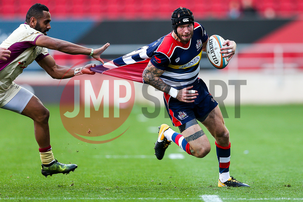 Ryan Edwards of Bristol Rugby is tackled by Andy Bulumakau of Doncaster Knights - Rogan/JMP - 22/10/2017 - RUGBY UNION - Ashton Gate Stadium - Bristol, England - Bristol Rugby v Doncaster Knights - B&I Cup.