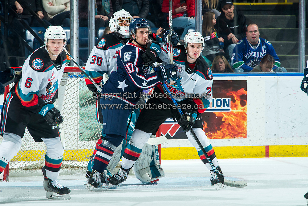 KELOWNA, BC - FEBRUARY 12: John Little #17 of the Tri-City Americans checks Jake Lee #21 ahead of the net of Roman Basran #30 of the Kelowna Rockets during second period at Prospera Place on February 8, 2020 in Kelowna, Canada. (Photo by Marissa Baecker/Shoot the Breeze)