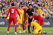 SYDNEY, AUSTRALIA - NOVEMBER 20: Australian forward Andrew Nabbout (11) stays down after a hit from Lebanon player Walid Ismail (18) at the international soccer match between Australia and Lebanon at ANZ Stadium in NSW, Australia. on November 20, 2018. (Photo by Speed Media/Icon Sportswire)