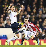 Kyle Walker of Tottenham Hotspur wind the ball ahead of Stefan Scougall of Sheffield United during the Capital One Cup Semi-Final 1st Leg match between Tottenham Hotspur and Sheffield Utd at White Hart Lane, London, England on 21 January 2015. Photo by David Horn.
